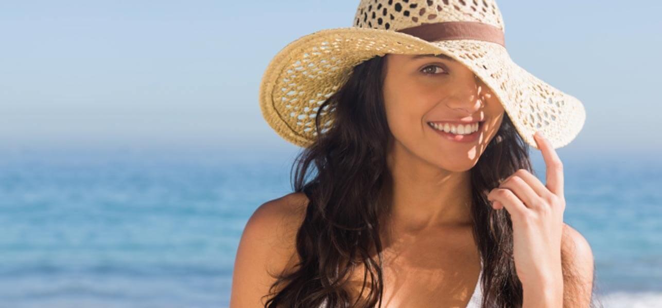 Tránh tác hại của nắng ảnh hưởng đến tóc